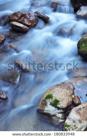 clear water of a mountain stream - stock photo