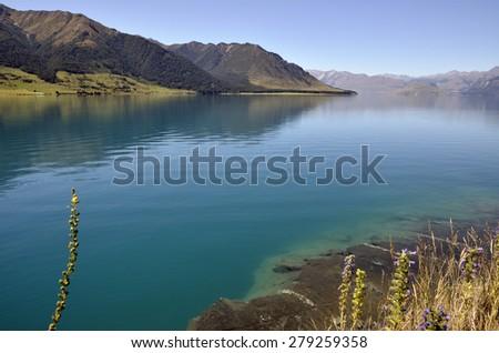 Clear water of Wakatipu lake in New Zealand. - stock photo