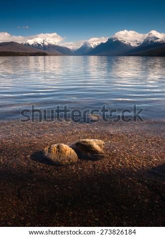 Clear Water Polished Rocks Lake McDonald Glacier National Park Montana - stock photo