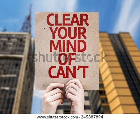 Clear Your Mind of Can't card with a skyscraper background - stock photo
