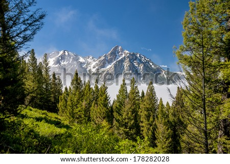 Clearing fog at the Sawtooth Mountains of Idaho. - stock photo