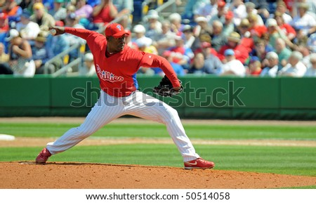 CLEARWATER, FL - MARCH 23: Philadelphia Phillies pitcher Jose Contreras  delivers a pitch in the March 23, 2010 spring training game in Clearwater, FL - stock photo