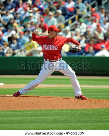 CLEARWATER, FL - MARCH 23: Philadelphia Phillies reliever Chad Durbin throws a pitch in the March 23, 2010 spring training game in Clearwater, FL - stock photo