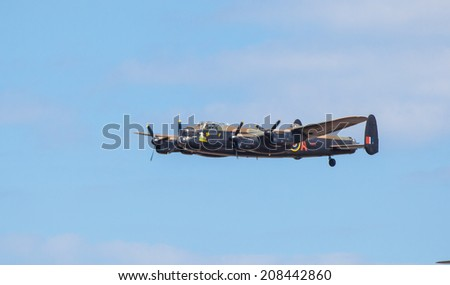 CLEETHORPES, ENGLAND JULY 27TH: Lancster Bomber from Battle of Britain Memorial flight performs a fly past Cleethropes airshow on 27th July 2014 in Cleethorpes England. - stock photo