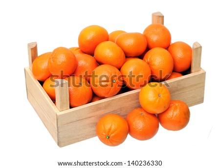 clementine mandarin in wooden crate isolated on white - stock photo