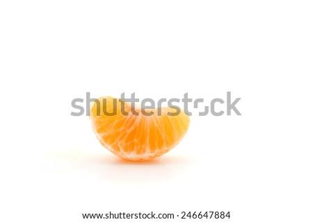 Clementine orange wedge isolated over white background. - stock photo