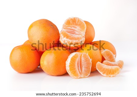 Clementines unpeeled and peeled - isolated - stock photo