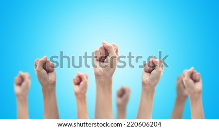 Clenched fists raised in protest. - stock photo