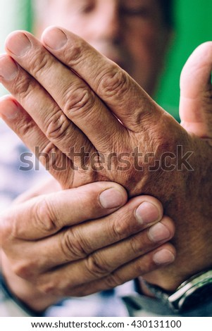 Clenched painful hands  - stock photo