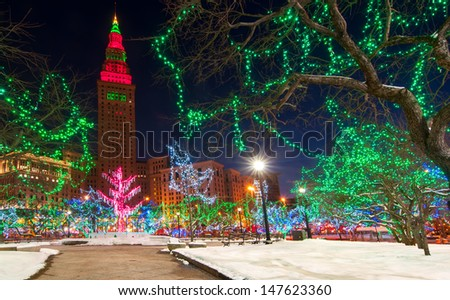 CLEVELAND, OH - DECEMBER 30: The Terminal Tower and Public Square in Cleveland Ohio are colorfully lit up for the Christmas season on December 30, 2012. The lighting is an annual attraction. - stock photo