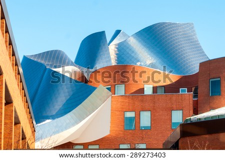 CLEVELAND, OH - FEBRUARY 28 2015: The Peter B. Lewis building, designed by renowned architect Frank Gehry, glistens in late afternoon sunlight on the campus of Case Western Reserve University.
