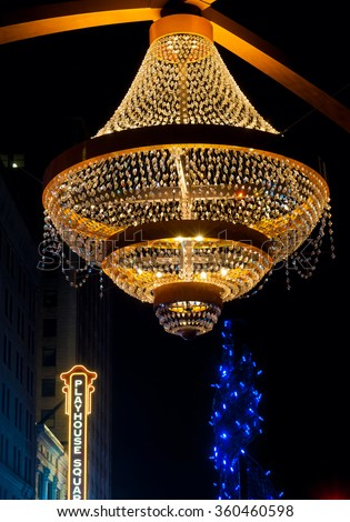 CLEVELAND, OH - JANUARY 1, 2016: One of Cleveland's splashiest new landmarks is the giant GE chandelier suspended above Euclid Avenue in the theater district, Playhouse Square, seen here at Christmas. - stock photo