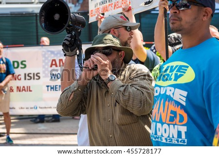 CLEVELAND, OH - JULY 20, 2016: A hard-core, far-right street preacher harangues the crowds in an impromptu rally during the Republican National Convention.