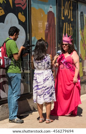 CLEVELAND, OH - JULY 20, 2016: A representative of Code Pink, an antiwar group that infiltrates GOP conventions, is interviewed on the street during the Republican National Convention