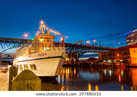 CLEVELAND, OH - JULY 24 2015: The Nautica Queen, offering daily sightseeing and dinner cruises on Lake Erie and the Cuyahoga River, is seen moored to her dock after an evening cruise. - stock photo