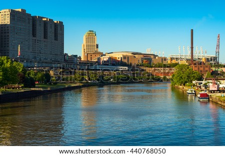 CLEVELAND, OH - JUNE 17, 2016: Quicken Loans Arena (the Q) and Progressive Field on the Cuyahoga River. The Q is the home of the NBA champion Cavaliers and site of the Republican National Convention. - stock photo