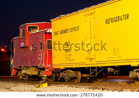 CLEVELAND, OH - MAY 9, 2015: A vintage box car and caboose are on display at the Midwest Railway Preservation Society, a volunteer organization dedicated to preserving America's railroad heritage. - stock photo