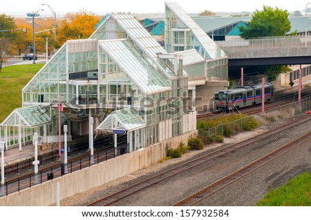 CLEVELAND, OH - OCTOBER 5: A rapid transit train approaches the North Coast station, the stop for the Rock and Roll Hall of Fame and Great Lakes Science Center in Cleveland Ohio on October 5, 2013,  - stock photo