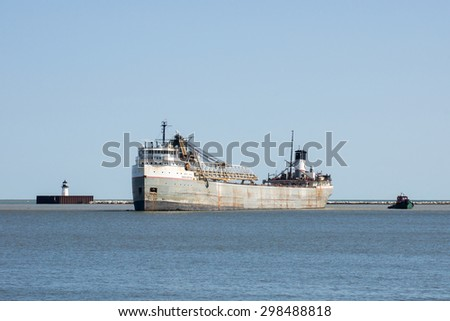 CLEVELAND, OHIO - JULY 16, 2015: The 72 year old Great Lakes bulk carrier Manistee arrives at the Port of Cleveland, Ohio en route to the Cargill Salt facility on the Cuyahoga River. - stock photo