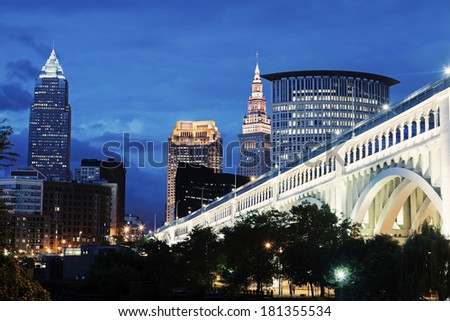 Cleveland skyline with bridge over Cuyahoga River. - stock photo