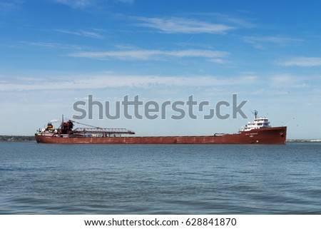 CLEVELAND, USA, APRIL 26, 2017: The Lee A. Tregurtha, a Great Lakes bulk carrier built in 1942, prepares to make a reverse move across the harbor in Cleveland, Ohio to the Cleveland Bulk Terminal