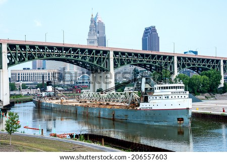 CLEVELAND, USA - JULY 22: Launched as the Adirondack in 1943, the 71 year old Manistee prepares to offload aggregate materials onto the bank of the Cuyahoga River at Cleveland, Ohio on July 22, 2014.