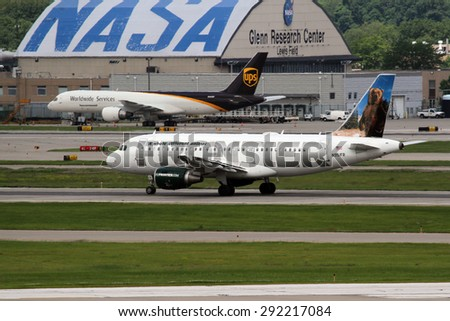 CLEVELAND, USA - JUNE 30, 2015: Airbus A319-112 of Frontier Airlines at Cleveland Hopkins International Airport. Landing in front of the NASA Glen Research