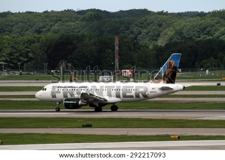 CLEVELAND, USA - JUNE 30, 2015: Airbus A319-112 of Frontier Airlines at Cleveland Hopkins International Airport.