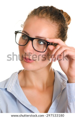 Clever business woman with glasses looking to the side - isolated over a white background. - stock photo