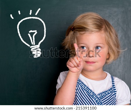 clever girl in front of black board - stock photo