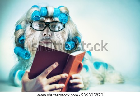 Clever long hair dog with mans face in glasses reading book. Mutation and genetic modification  fun concept.
