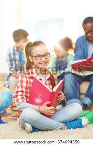 Clever schoolgirl - stock photo