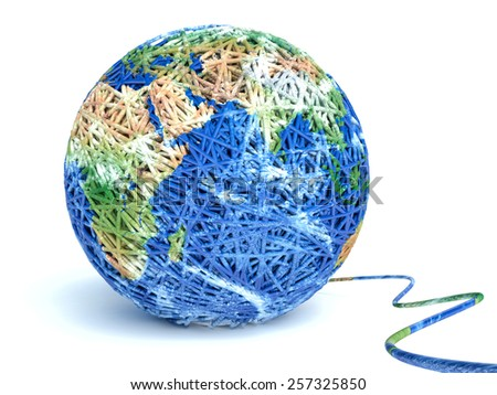 Clew of wool forming a world globe - stock photo