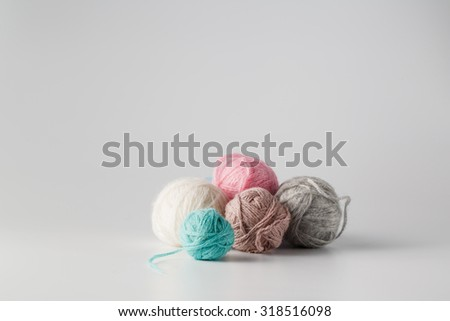Clews of colored wool yarn. Place for text - stock photo