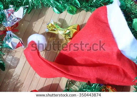 Click Christmas hat laying on brown background