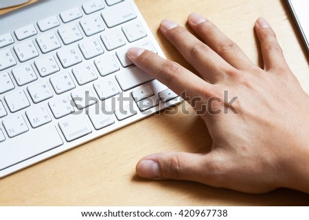 Click, Hands of a man on a keyboard, business concept