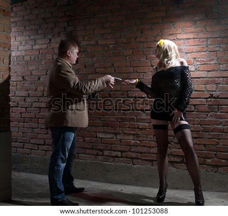 client and prostitute in gateway - stock photo