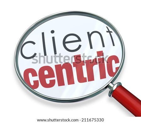 Client Centric words under a red magnifying glass illustrating a business model focused on the needs of serving customers first - stock photo