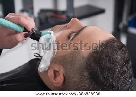 shaving process barber shop stock photo 306021122. Black Bedroom Furniture Sets. Home Design Ideas