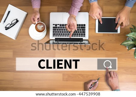 CLIENT man touch bar search and Two Businessman working at office desk and using a digital touch screen tablet and use computer, top view - stock photo