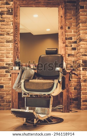 Client's chair in barber shop - stock photo