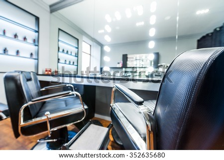 Client's chair in barber shop.Selective focus. - stock photo