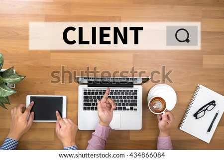 CLIENT Two Businessman working at office desk and using a digital touch screen tablet and use computer - stock photo