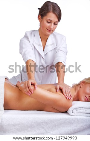 Clients scapula is being treated by therapist - stock photo