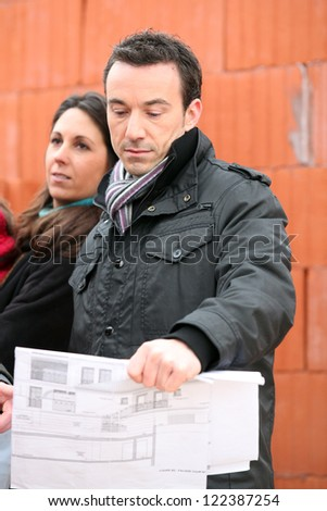 Clients visiting building site - stock photo