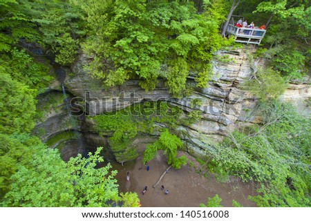 Cliff and hikers on observation deck - stock photo
