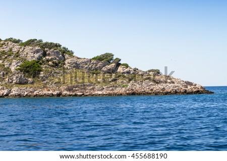 Cliff at Adriatic sea by National Park Kornati in Croatia at Adriatic sea, Mediterranean, Europe - stock photo