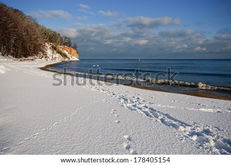 Cliff by the sea in Gdynia, winter beach  - stock photo