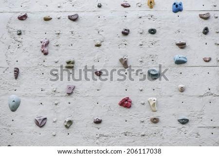 Cliff climbing practice wall. - stock photo