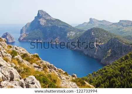 Cliff coast with bay in Spain - stock photo